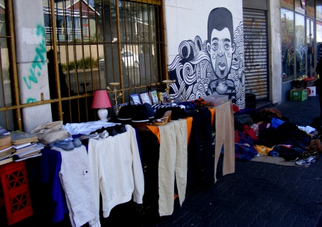 Clothes and second goods are sold on the sidewalk