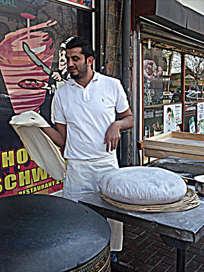 Making laffa bread on the street corner. The House of Schwarmas is where we stopped for lunch - it was delicious. They give you a bit of show outside while making the laffa bread that they wrap your schwarma in.