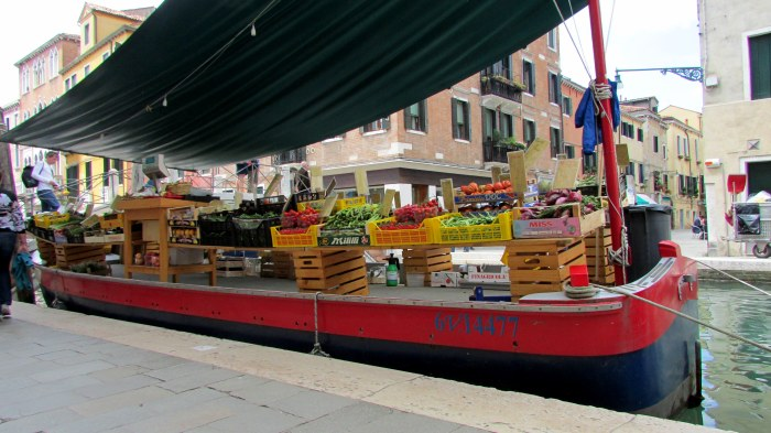 A fruit and vegetable market on a boat
