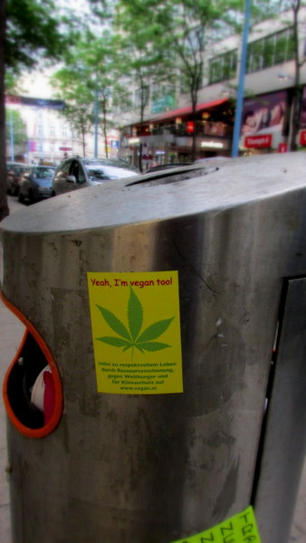 A comical sticker on how smoking the doobi is saving the planet, found in Vienna, Austria