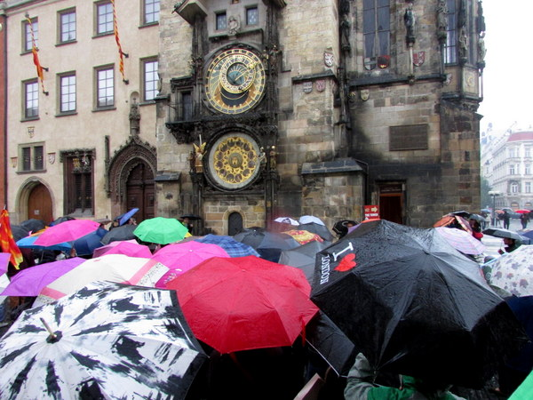 Tourists gathering to watch the Astronomical clock do its song and dance
