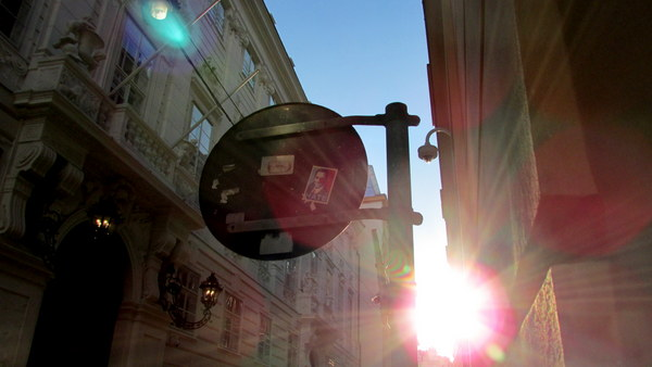 How could you hate this? A beautiful shot of the sun peeking through the city buildings in Vienna, Austria.