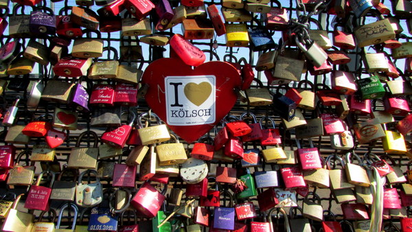 Not quite a graffiti sticker, but a sticker nonetheless. You will always find the typical 'I <3_'. This one was stuck on a love lock on the bridge in Cologne, Germany. Expressing eternal love the wonderful Kolsh?