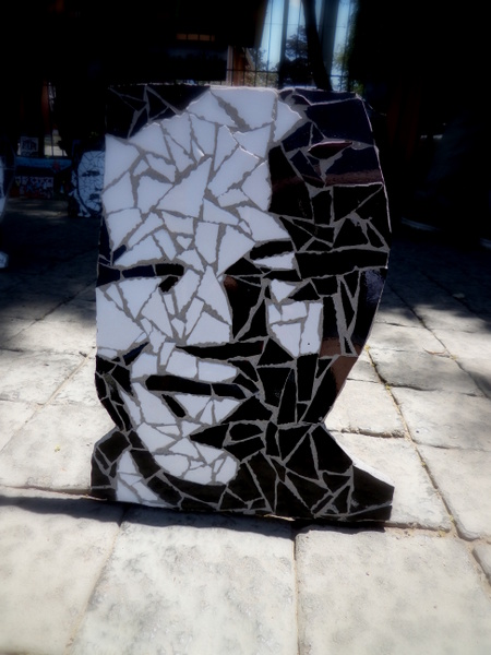 There were some really cool mosaic art pieces on sale in the street market outside of The Hector Pieterson Memorial. I loved this one of Nelson Mandela.